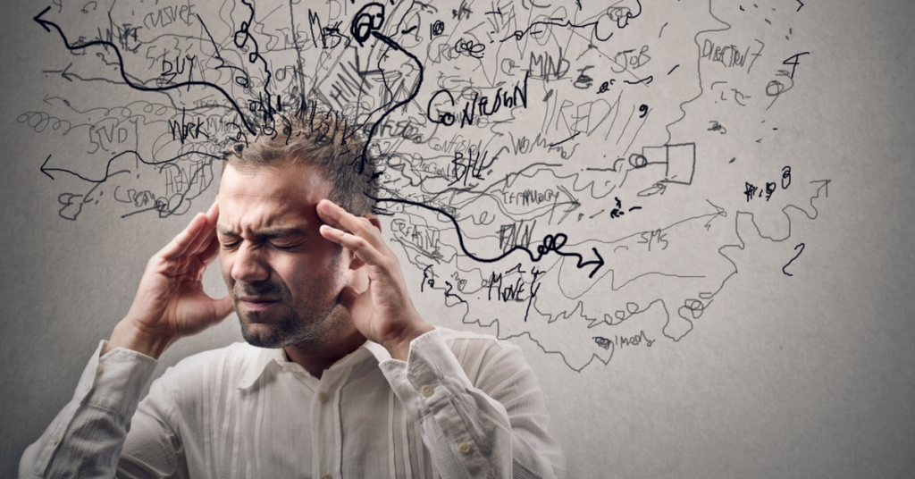 Photo illustration showing a man experiencing anxious thoughts