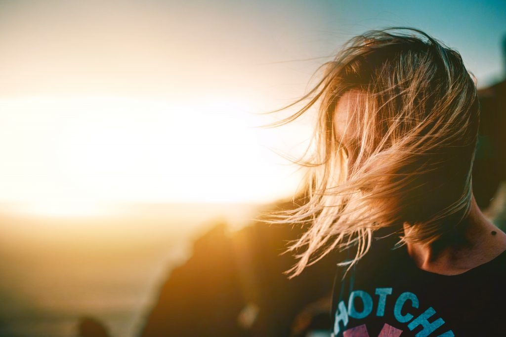 Image of blonde woman with hair blowing in the breeze NLP